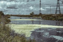 Waste water from the power plant polluting substances entering the natural river royalty free stock images