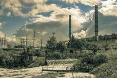 Waste water from the power plant polluting substances entering the natural river stock images