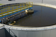 Waste water treatment plant. Round basin filled with waste-water ready for cleaning treatment in plant Stock Photography