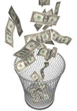 Wastebasket with dollars. Metal wastebasket with dollars falling in Royalty Free Stock Images