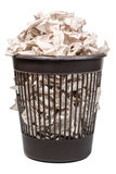 Wastebasket with toilet paper. Plastic trash can full of crumpled paper isolated on white background Stock Photography