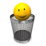 Wastebasket Yellow Smiley. Yellow smile in the wastebasket on the white background Royalty Free Stock Images