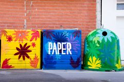 Wastebaskets of recycling. Decorated with showy floral drawings Royalty Free Stock Images