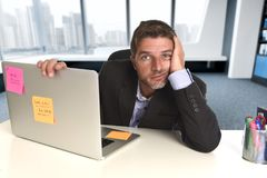 Wasted businessman working in stress at office laptop computer looking exhausted royalty free stock image