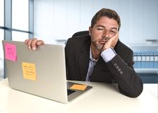 Wasted businessman working in stress at office laptop computer looking exhausted stock images