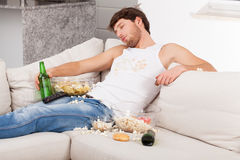 Wasted man surrounded by mess Royalty Free Stock Images