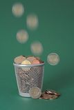 Wasted money - coins Stock Photo