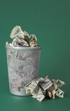 Wasted money - Dollar bills. Photo of a waste basket full of money Royalty Free Stock Photography