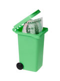 Wasted money. One green miniature recycle bin with a Swedish one hundred krona bannknote inside  on white Stock Images