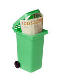 Wasted money. One undred Dannish kroner banknote inside an opened green recycling bin isolated on white background Royalty Free Stock Photo