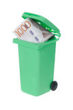 Wasted money in a recyle bin. One green recycle bin with a wasted Swedish banknote 1000 krona visible inside isolated on white background Stock Images