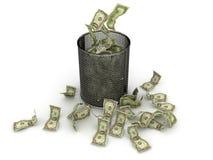 Wasted money. US dollar bills falling inside the trash bin Stock Images