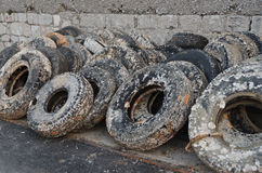 Wasted old tyres in the harbour Royalty Free Stock Image