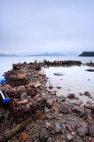 Wasted stuffs at the coastline. Some wasted stuffs at the coastline Royalty Free Stock Photo