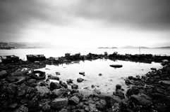 Wasted stuffs at the coastline. Some wasted stuffs at the coastline, black and white Royalty Free Stock Photos