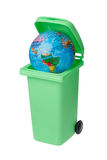 Wasted world. The Earth inside a green recycling bin with an open lid isolated on white Royalty Free Stock Photos