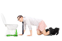 Wasted young man crawling to a toilet Royalty Free Stock Photography