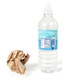 Wasteful disposables. Paper lunch bag & plastic water bottle - disposable, not reusable Royalty Free Stock Images