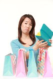 Wasteful Japanese woman with empty wallet. Studio shot of Japanese woman on white background Stock Images