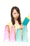 Wasteful Japanese woman with empty wallet Royalty Free Stock Photo