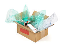 Wasteful packaging. Shipping container with plastic bags and various wrappings Royalty Free Stock Image