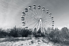 Wasteland with abandoned Ferris wheel. Wasteland and abandoned Ferris wheel, Pervouralsk, Urals, Russia Royalty Free Stock Photo