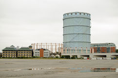Wasteland, Battersea. View across deserted wasteland beside the derelict power station in Battersea, Wandsworth, London.  Ahead is a disused gas holder and to Royalty Free Stock Image