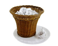 Wastepaper Basket. An old-fashioned, wicker wastebasket full of crumpled paper. Isolated over pure white stock photos