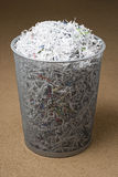 Wastepaper basket filled with shredded paper Stock Images