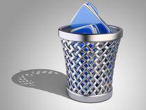 Wastepaper basket with folders Stock Photos