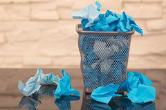 Wastepaper basket with wrinkled paper Stock Images