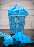 Wastepaper basket with wrinkled paper Royalty Free Stock Photo