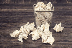 Wastepaper basket with wrinkled paper Stock Photography