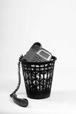 Wastepaper con el teléfono de la viejo-manera Imágenes de archivo libres de regalías