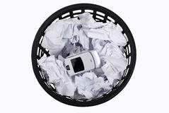 Wastepaper with  papers and  phone Royalty Free Stock Images