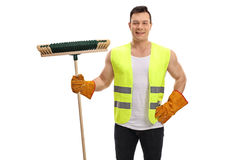 Waster collector holding a broom Royalty Free Stock Images