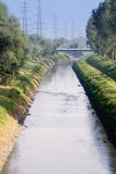 Wastewater canal with the sewage of millions of people Royalty Free Stock Image