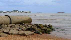 Wastewater pipe on sea sand beach