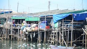 Wastewater and pollution and garbage in the sea. At Ang Sila Fishing village and seafood Market in Chonburi, Thailand stock video footage