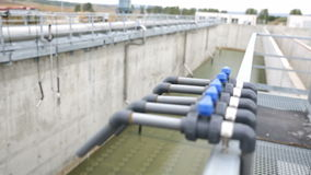 Wastewater treatment facility valves pipes defocus stock video