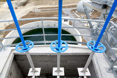 Wastewater treatment facility valves pipes Royalty Free Stock Image