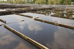 Wastewater. Treatment plant aerating basin Royalty Free Stock Photography