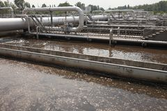 Wastewater. Treatment plant aerating basin Royalty Free Stock Photos