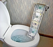 Money in a toilet bowl Stock Photography