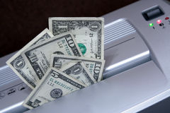 Wasting Money. Money placed in a paper shredder. Concept: Wasting money Stock Photos