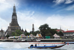 Wat Arun. Long tail motor boat cruise in front of Wat Arun in Chaopraya river Royalty Free Stock Images