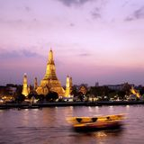 Wat Arun across Chao Phraya River during sunset. Twilight view of Wat Arun across Chao Phraya River during sunset in Bangkok, Thailand Royalty Free Stock Photography