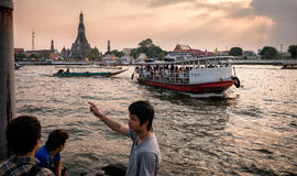 Wat Arun. As seen from other side of the river. Ferry in the foreground Stock Image