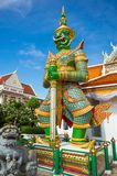 Wat Arun, Bangkok - photo of one the temple`s gates with the gigantic guardians protecting it. Background stock image
