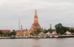Wat Arun in Bangkok. Wat Arun or Temple of the Dawn in Bangkok on the river side Stock Image